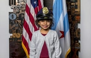 child with cop hat